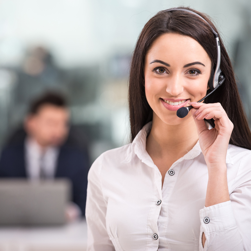 Lady at a call centre using a headset